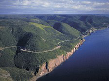 An aerial view of the park from the Gulf. The Cabot Trail winds around the edge of the plateau.