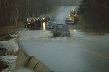Road crews work to repair damage done to the Cabot Trail after a particularly severe tropical marine storm.