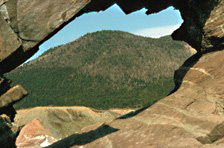 A view of the plateau through a naturally carved sea arch at Trout Brook, since collapsed.