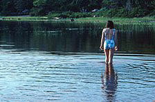 A woman wading in Warren Lake.
