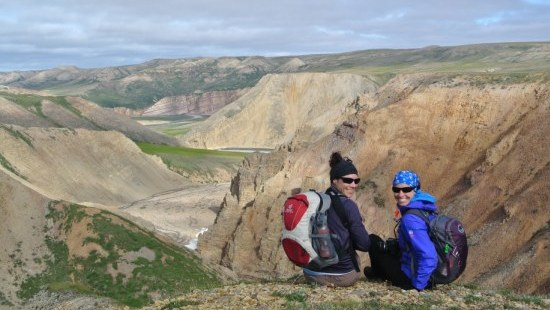 Two hikers sit and enjoy the view of the Brock River valley