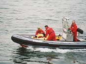 Park Warden carrying out an evacuation drill for an injured person, from a boat