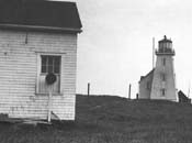 Historic photograph of the first lighthouse on île aux Perroquets