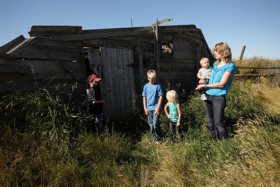 A family explores around the buildings at the Larson homestead site.