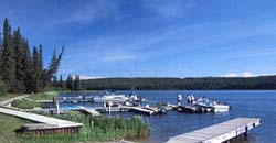 Boats docking at marina on Waskesiu Lake Narrows.