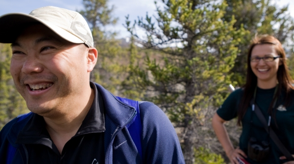 Visitor and Parks Canada staff enjoys a moment of laughter