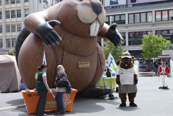 Parks Canada's inflatable beaver and our new mascot, Parka, in Dundas Square.