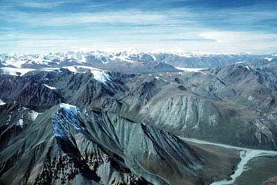 Aerial view of mountains including Table Top mountain. A small river can be seen in the lower right hand.