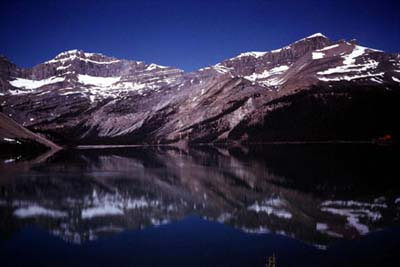 Picture of Jasper Lake, mainly, with two mountains in the background.